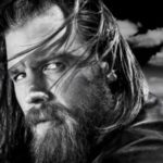 John Travolta and Ryan Hurst Separated at Birth?