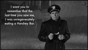 the-americanization-of-emily-charlie-in-the-rain-unregenerately-eating-a-hershey-bar